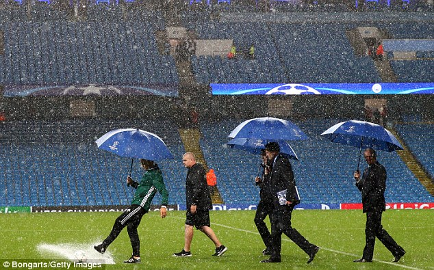 The Dutch match official is seen kicking the ball during the pitch inspection on Tuesday night