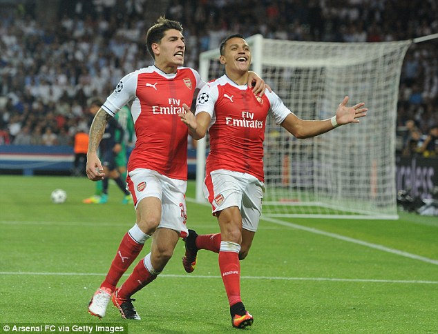 Alexis Sanchez (right) celebrates with Hector Bellerin having scored for the Gunners