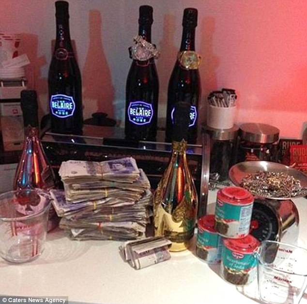 One picture shows wads of £20 notes stacked up on a kitchen worktop, surrounded by booze