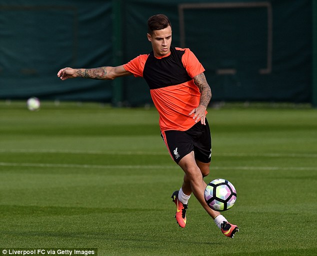 Brazilian Philippe Coutinho appears to float in the air as he hones his skills at Melwood