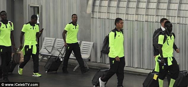 (L-R) Divock Origi, Georginio Wijnaldum, Nathanial Clyne, Roberto Firmino and Sadio Mane make their way to a train heading for London