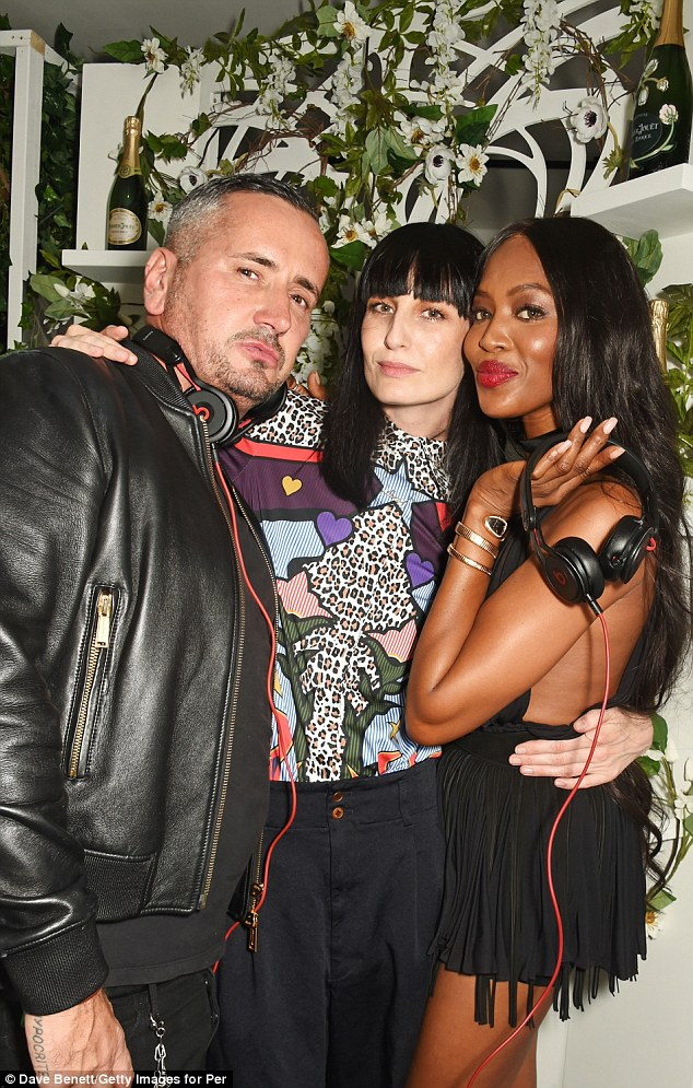 Firm friends: Tony and Naomi put their arms around English model Erin O'Connor