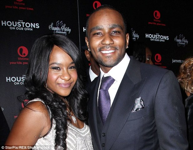 Legal troubles: Nick Gordon skipped a mandatory court appearance on Friday in the wrongful death suit filed against him by Bobbi Kristina's estate (Gordon and Bobbi Kristina above in 2012)
