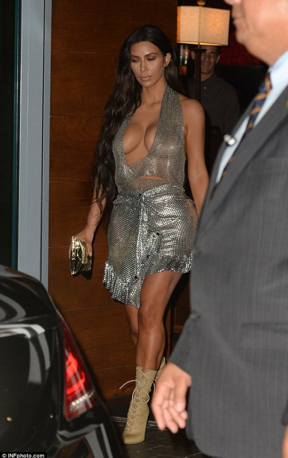Lacy and racy: The mother-of-two matched her metallic outfit with a pair of fawn-coloured, lace-up boots