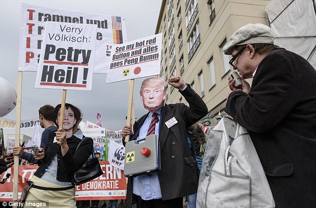 Protesters wore masks of Ms Petry and Donald Trump at a protest against the Transatlantic Trade and Investment Partnership in Berlin today