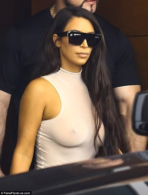No bra, no problem:While her bra's absence seemed surprising at first, it is fast becoming clear that this is Kim's new favourite outfit choice