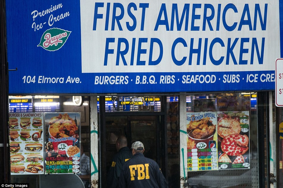 The Rahami family also appear to own the fried chicken shop that they live over in Elizabeth. Above FBI agents are seen entering the fried chicken restaurant on Monday