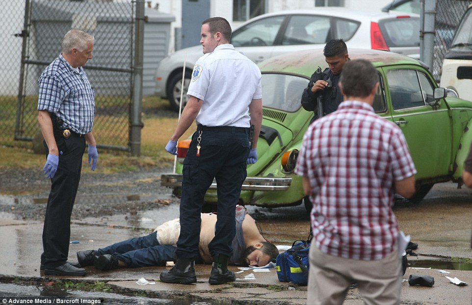 Ahmad Khan Rahami has been taken into custody after a shootout with police in Linden, New Jersey Monday morning. Rahami is pictured laying on the ground with his hands restrained behind his back above after the shootout