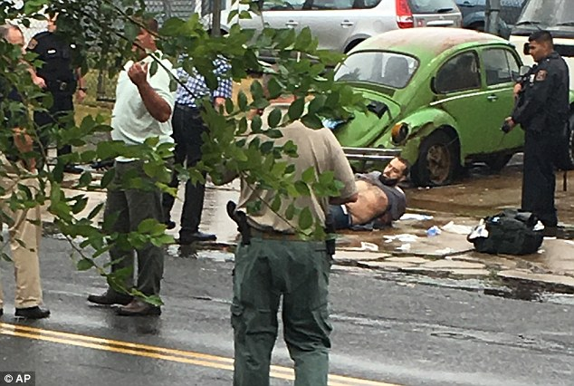 Captured: This was the moment Ahmad Rahami was arrested after a shoot-out in which two police were injured in Linden, NJ
