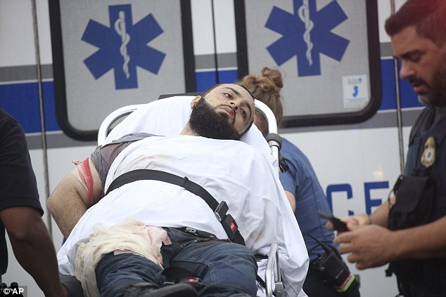 Ahmad Khan Rahami, 28, was taken into custody on Monday after a shootout with police in Linden, New Jersey. He is seen above being taken from the scene on a stretcher