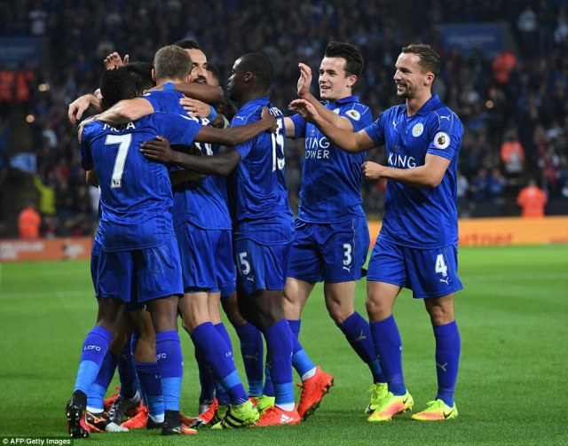 The Foxes players mob Okazaki after his headed goal gave the Premier League champions the lead in the EFL Cup tie