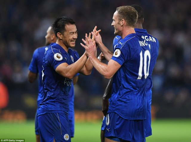 Okazaki celebrates his second goal with team-mate Andy King, who played a sublime through ball to set up the Leicester goal