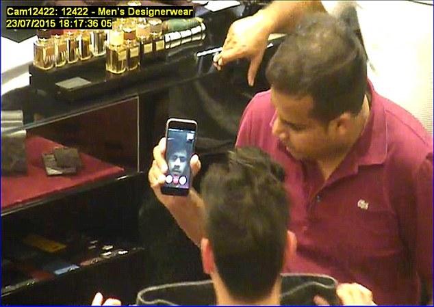 CCTV shows Hameed (on screen) shopping for designer jeans using the FaceTime app