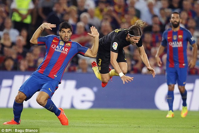 Filipe Luis goes flying after a foul by Luis Suarez during Atletico Madrid's trip to Barcelona