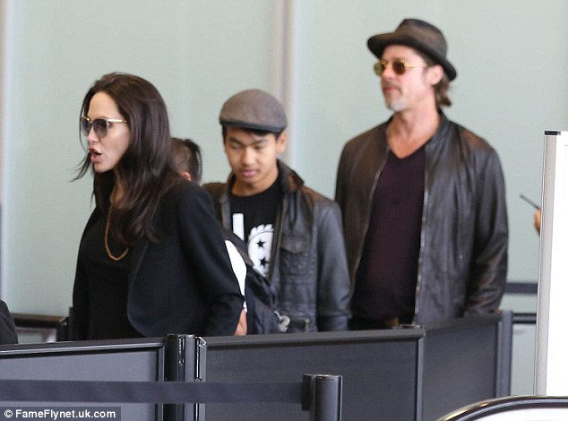 Jolie, Maddox and Pitt are seen on June 6, 2015, departing on a flight from Los Angeles