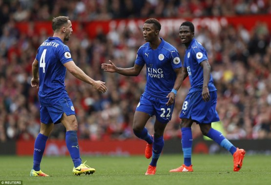 Gray celebrates with Danny Drinkwater and Daniel Amartey after reducing the arrears during the second half