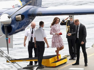 Prince William offered a helping hand to his wife as she stepped off the seaplane in teetering red stilettos