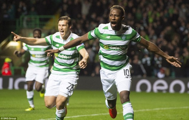 Moussa Dembele (right) spreads his arms wide in celebration after putting Celtic 1-0 up inside three minutes in Glasgow
