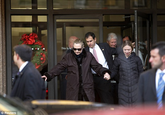 Clinton leaves New York Presbyterian Hospital with husband Bill and daughter Chelsea on January 2, 2013, just weeks after suffering a concussion