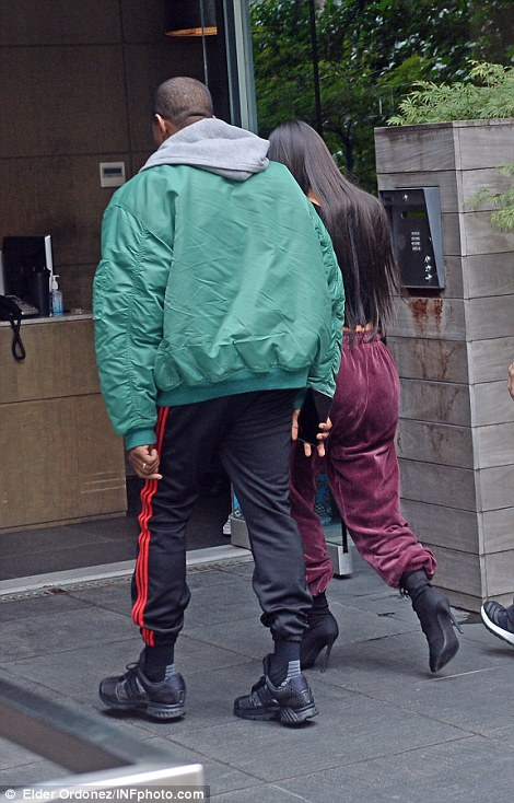 Kardashian was met by husband Kanye West as she returned to New York - she was reportedly 'very pleased' to be back in US