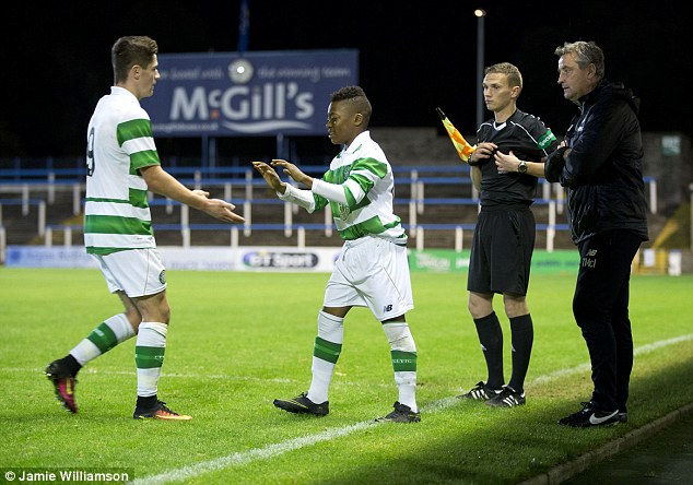 The teenager made history by coming on as a substitute on Monday night to make his debut
