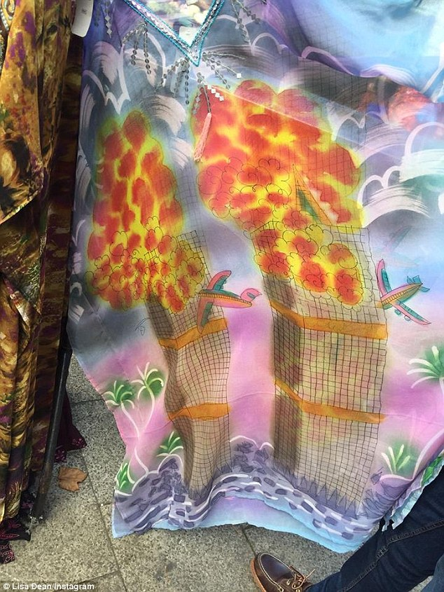 Shocking: The £5 dress features a large colourful drawing of the World Trade Center with two aircraft smashing into each of the towers and flames coming out of the top.