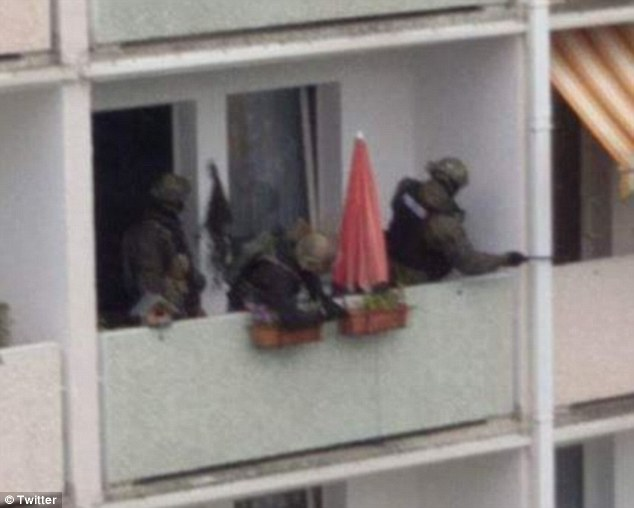 Officers are surrounding a home in Chemnitz and the force tweeted: 'At the moment we have a static threat situation in the Fritz-Heckert area in Chemnitz, C0810 and with strong forces on the ground.'