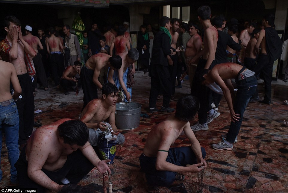 Tradition: Pools of blood can be seen on the floor of the building after the men performed the ritual to mark Ashura - one of the major fixtures of the Islamic calendar
