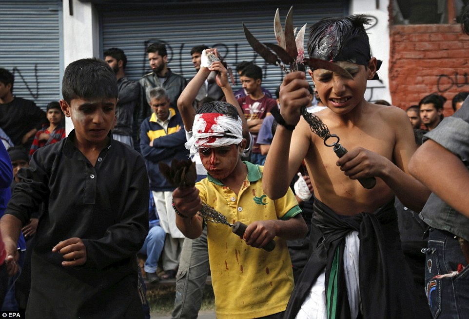 Kashmiri Shiite Muslim children flagellate themselves as they mourn the death of Imam Husain, the grandson of Prophet Muhammad