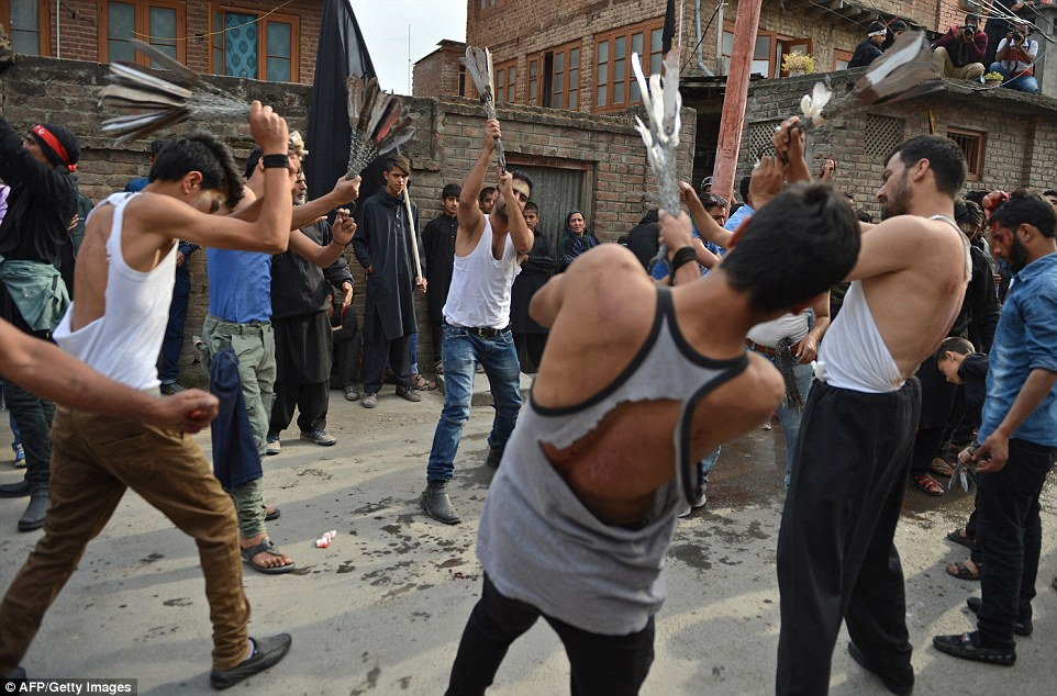 Graphic pictures show the men swinging chains with knives attached over their shoulders as part of the bloody ritual