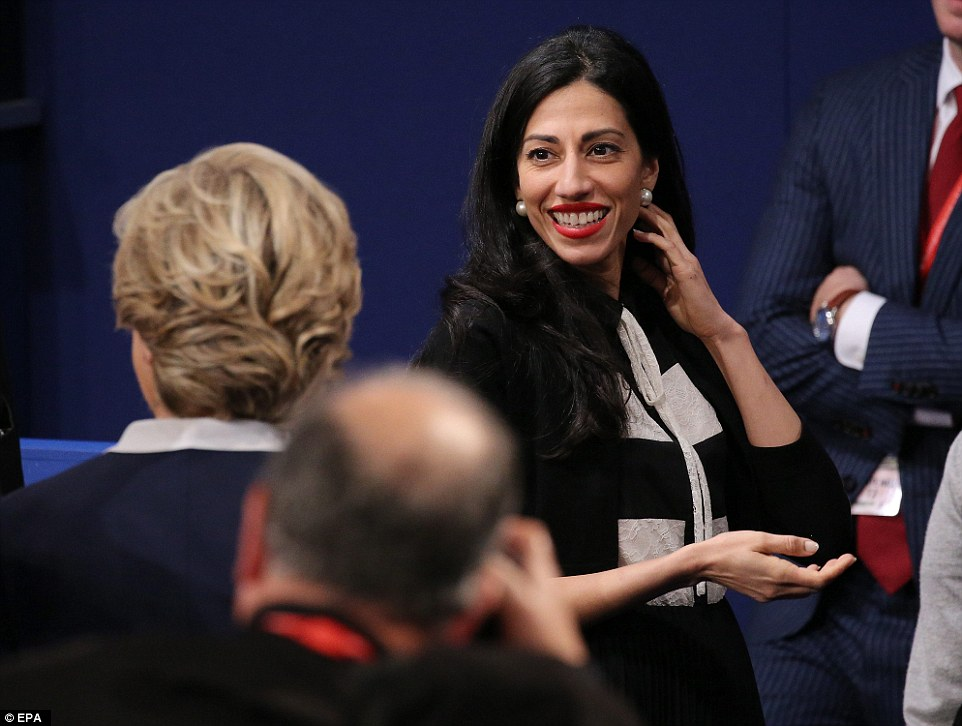 Hillary Clinton campaign vice chair Huma Abedin (R) and Democrat Hillary Clinton (L) at the end of the second Presidential Debate