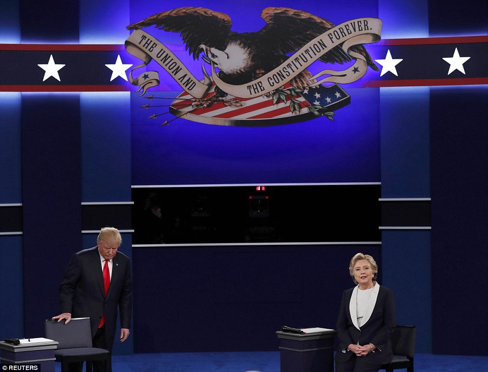 Republican U.S. presidential nominee Donald Trump and Democratic U.S. presidential nominee Hillary Clinton take the stage at the start of their presidenti