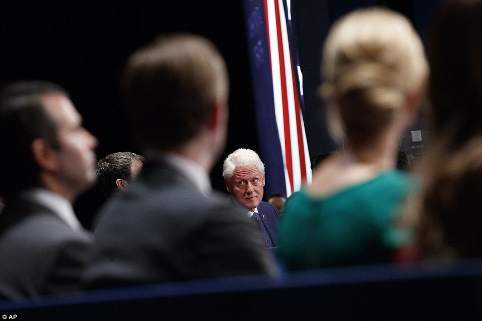 Former president Bill Clinton waits for the start of the second presidential debate in St Louis, Missouri, on Sunday night