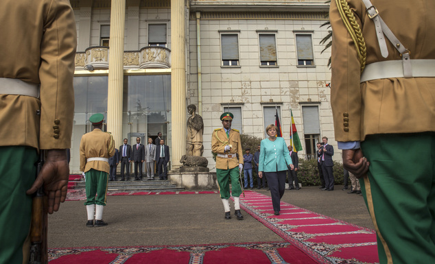German Chancellor Angela Merkel, center-right, inspects the honor guard at the national palace in Addis Ababa, Ethiopia Tuesday, Oct. 11, 2016. Merkel is vis...