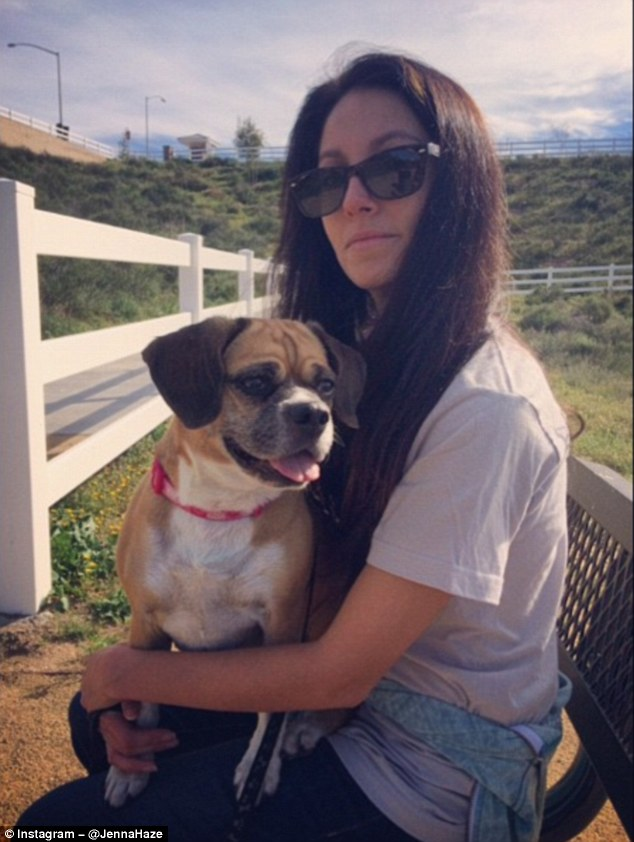 Jenna Haze, star of hundreds of adult films, takes her puggle Sable, for a walk