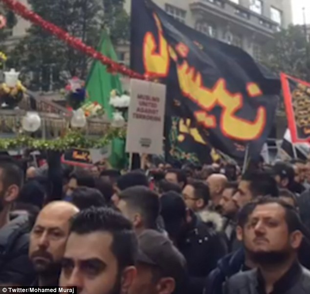 Thousands of Muslims marched through London today, pictured, for the Ashura Festival