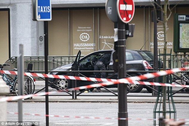 After the controlled explosion, police were seen searching the vehicle parked next to Madeleine Metro