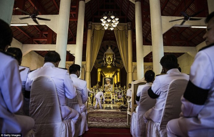 Government, military, and community leaders wait for the beginning of a ceremony at Wat Phra Singh in Chiang Mai
