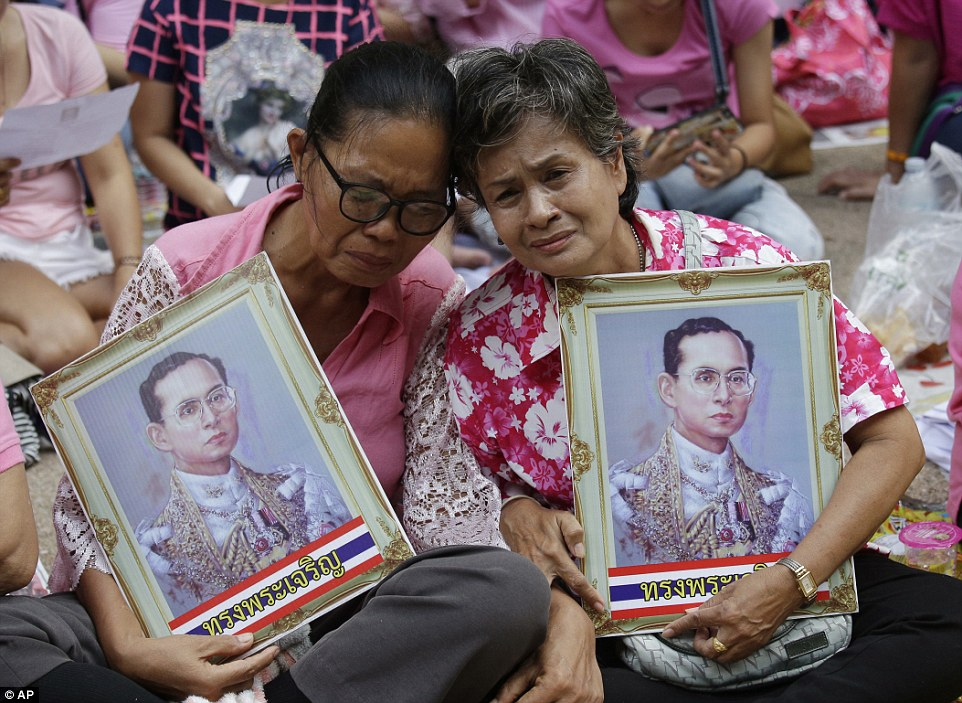 Mourners sat for hours in Bangkok's urban heat awaiting the passage of his motorcade, in scenes reminiscent of religious devotees