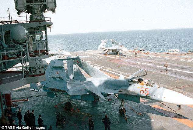 Admiral Kuznetsov, a heavy aircraft-carrying missile cruiser, is the flagship of the Russian Navy (pictured, sailors on the Kuznetsov's deck)