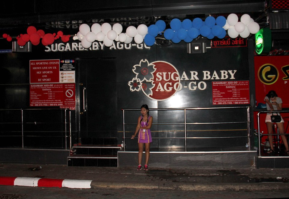 'The Sugar Baby Ago-go Club is closed out of respect': Bars and clubs of the infamous Walking Street in Pattaya are empty as Thailand mourns death of its King