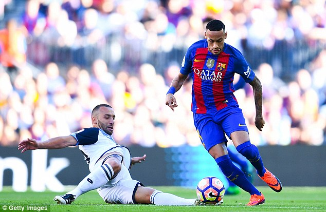 Neymar takes on the sliding challenge of Deportivo's Guilherme dos Santos