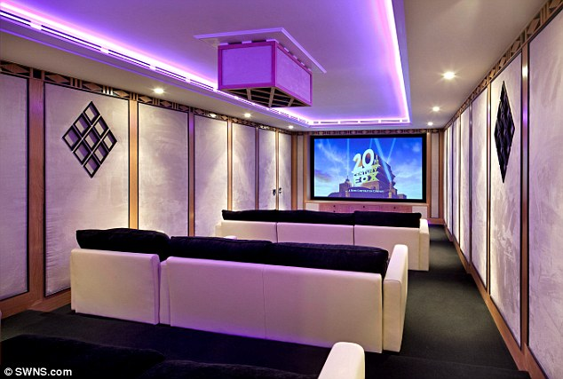 The home was a 'wreck' in 2006 but was renovated by a property tycoon and now comes with its own cinema, pictured