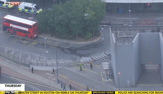 Police investigation: An aerial view of the scene at North Greenwich Tube station yesterday