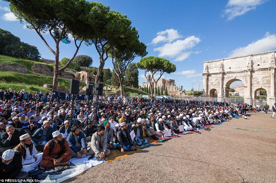 The Dhuumcatu Association, said police had closed three improvised mosques in Rome in last few months . They sat outside the iconic building for hours on Friday to protest (pictured)