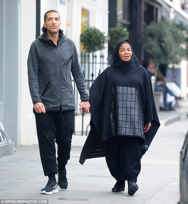 Comfy:The 50-year-old All For You hitmaker covered herself from head-to-toe in a billowing hooded poncho with baggy trousers and comfortable trainers