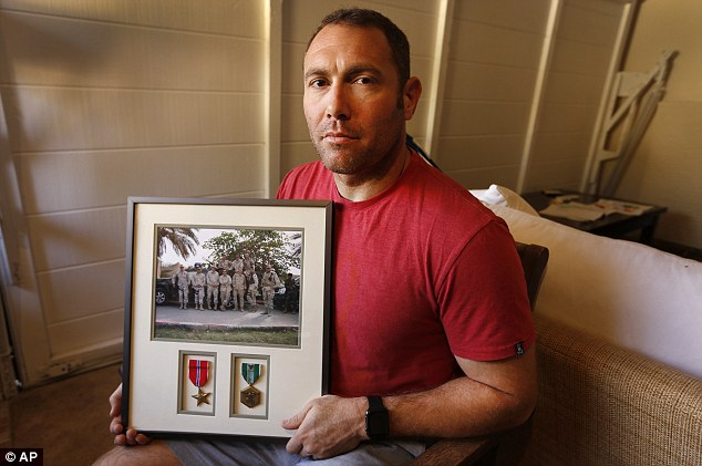 Retired Army major and Iraq veteran Robert D'Andrea (pictured) said he was told to repay his $20,000 because auditors could not find a copy of the contract he says he signed