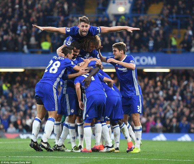 Chelsea players celebrate a stunning victory against Mourinho's Manchester United in the Premier League