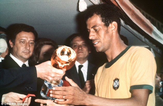 Alberto receives the Jules Rimet trophy in 1970 after Brazil beat Italy 4-1 in the World Cup final