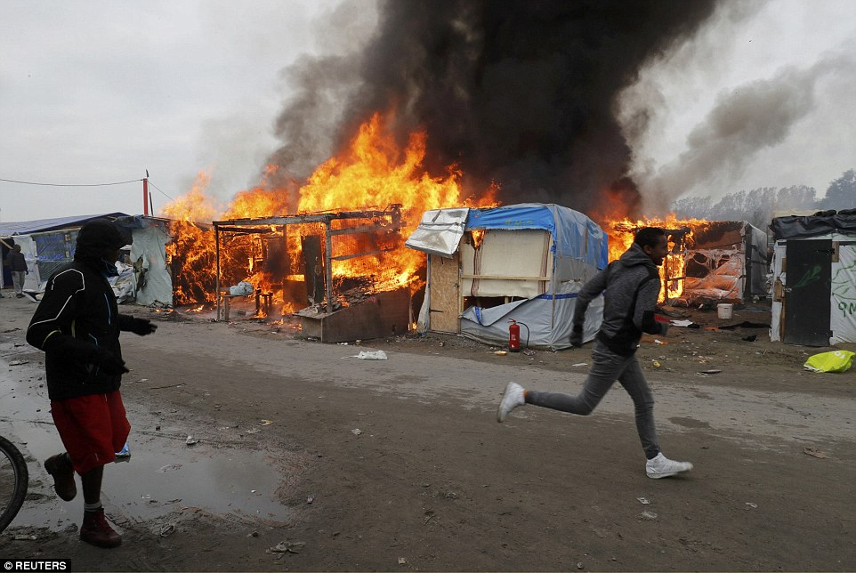 Commissioner Patrick Visser-Bourdon said migrants had told his officers anarchists sneaked into the camp in the early hours of the morning to set the blaze as an 'act of resistance'